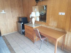 A television and/or entertainment center at Towne Center Motel