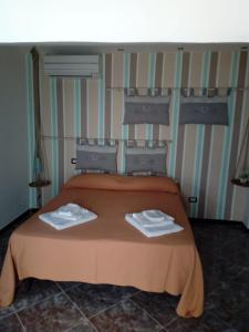 A bed or beds in a room at bed and breakfast Centro Storico