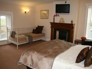 A bed or beds in a room at The Dyke Neuk inn