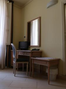 A television and/or entertainment center at Hotel Anna's