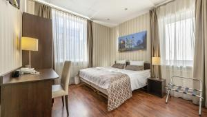A bed or beds in a room at Vilnius City Hotel