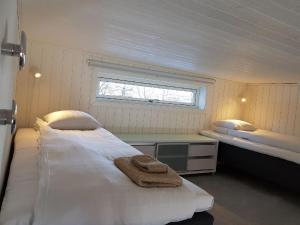 Säng eller sängar i ett rum på Nordicbo