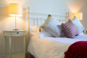A bed or beds in a room at Castlecor House - Historic Country House