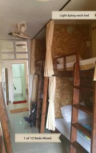 A bunk bed or bunk beds in a room at Chiangmai Gate Capsule Hostel Dormitory