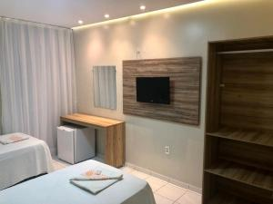 A television and/or entertainment center at Hotel Terra do Sal