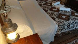 A bed or beds in a room at Antica Roccia