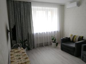 A seating area at Уютная квартира
