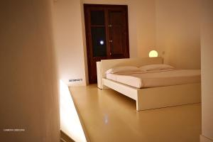 A bed or beds in a room at Diecizero Affittacamere