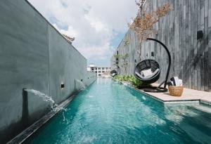 The swimming pool at or near Lloyd's Inn Bali