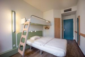 A bunk bed or bunk beds in a room at ibis budget Berlin Ost