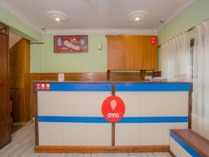 A kitchen or kitchenette at Waling Fulbari Guest House