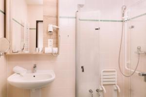 Ein Badezimmer in der Unterkunft JUFA Hotel Fürstenfeld