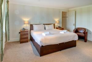A bed or beds in a room at Best Western Lord Haldon Hotel