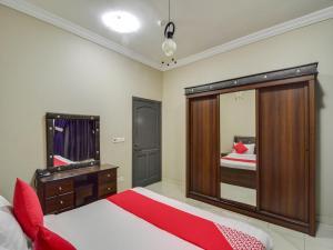 Uma TV ou centro de entretenimento em Ajwa Suites for Furnished Units