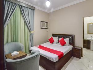 Cama ou camas em um quarto em Ajwa Suites for Furnished Units
