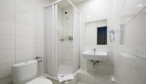 A bathroom at Vilnius City Hotel