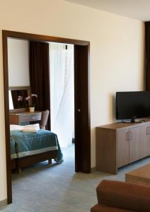 A bed or beds in a room at Baltic Plaza Hotel Medi Spa