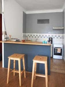 A kitchen or kitchenette at Appartement Opéra