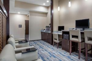 TV i/ili multimedijalni sistem u objektu Comfort Suites - South Austin