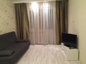 Телевизор и/или развлекательный центр в Apartment On Lenina 156