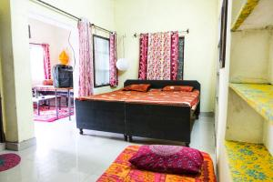 A bed or beds in a room at Nadya Homestay For Female & family