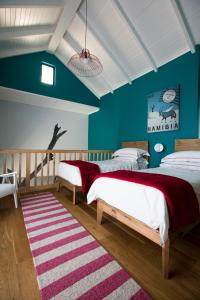 A bed or beds in a room at The Delight Swakopmund