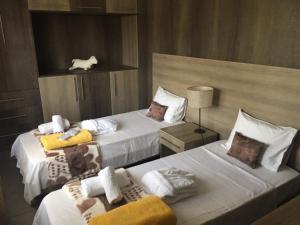 A bed or beds in a room at Naiades Almiros Beach Villa