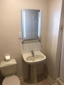 A bathroom at Tullochwood Lodges