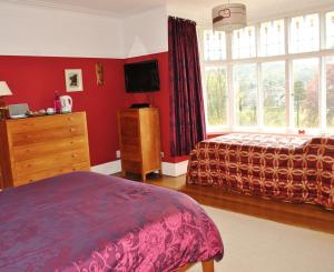 A bed or beds in a room at Crabble Hill House