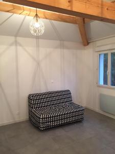 A seating area at Studio Indépendant - Quartier Résidentiel