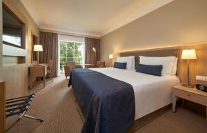 A bed or beds in a room at Hotel Porto Santa Maria - PortoBay - Adults Only