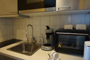 Een keuken of kitchenette bij B&B Bosrand
