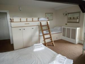 A bunk bed or bunk beds in a room at The Dyke Neuk inn