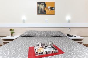 Cama ou camas em um quarto em Hotel Express Centro Histórico