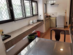 A kitchen or kitchenette at 7HCR Residencies 1BR 1-4