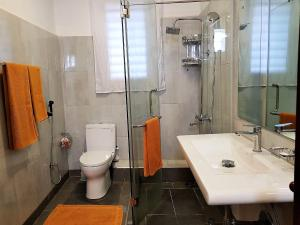 A bathroom at 7HCR Residencies 1BR 1-4