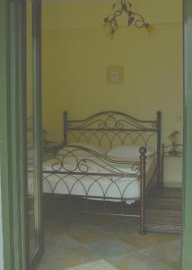 Ένα ή περισσότερα κρεβάτια σε δωμάτιο στο Villa Platanaki