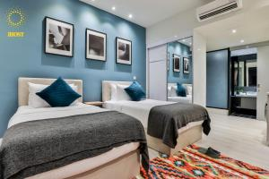A bed or beds in a room at Expressionz Suites By iHost Global