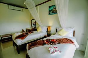 Ein Bett oder Betten in einem Zimmer der Unterkunft Luangprabang View Hotel