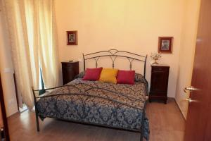 A bed or beds in a room at SALERNUM - MONTE MARE