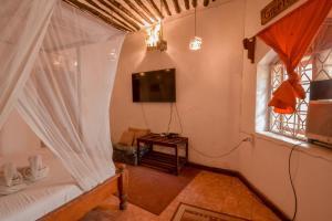 Ein Sitzbereich in der Unterkunft Malindi Guest House