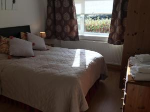A bed or beds in a room at Ashbourne Holiday Homes