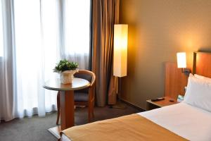 A bed or beds in a room at Holiday Inn Calais, an IHG Hotel