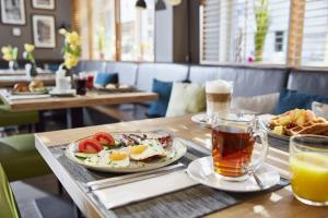 Een restaurant of ander eetgelegenheid bij Lindner Hotel City Plaza