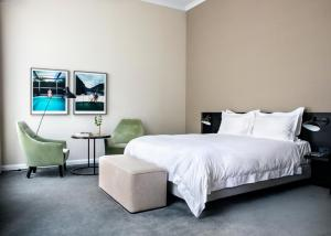A bed or beds in a room at Pillows Grand Boutique Hotel Ter Borch Zwolle
