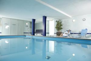 The swimming pool at or near Hotel Rennschuh