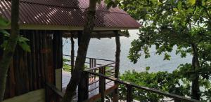 A balcony or terrace at Jungle Hill Beach Bungalow
