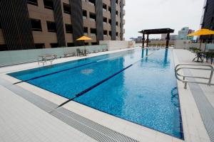Palais de Chine Hotel游泳池或附近泳池