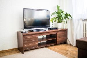 Telewizja i/lub zestaw kina domowego w obiekcie Aloe Cosy Home