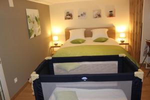 A bed or beds in a room at Chambre d'hotes Antony